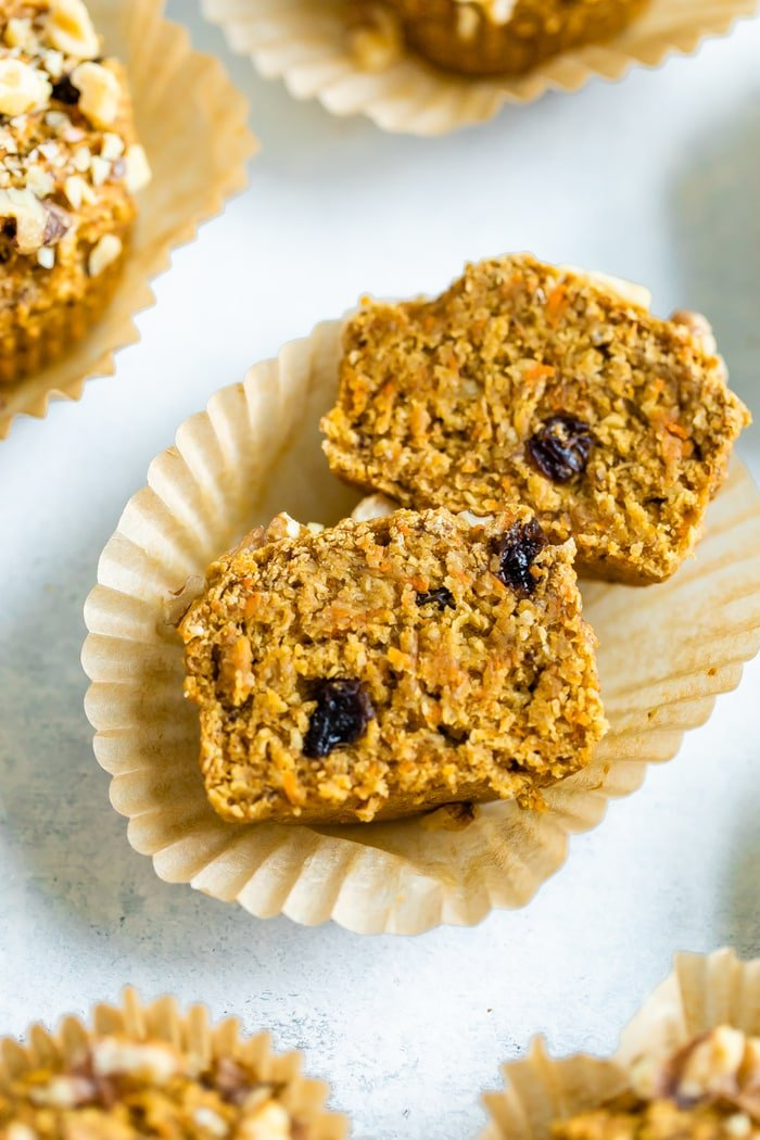 Oat bran muffin cut open. Muffin is made with carrots and raisins.
