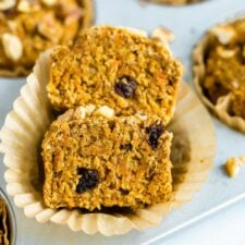 Oat bran muffin made with shredded carrots and raisins sliced in half.
