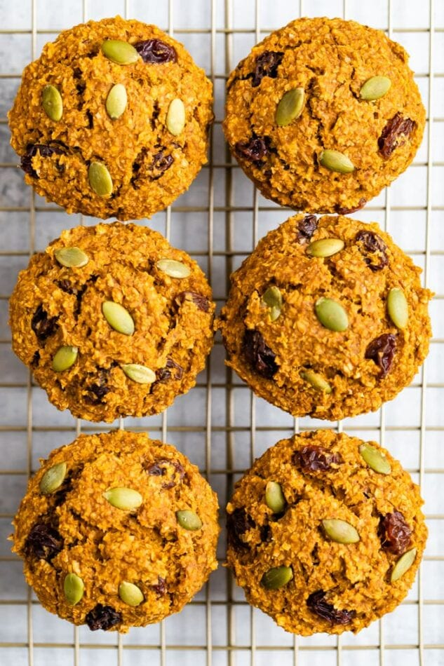 Six pumpkin bran muffins on a cooling rack, view from above the muffins.