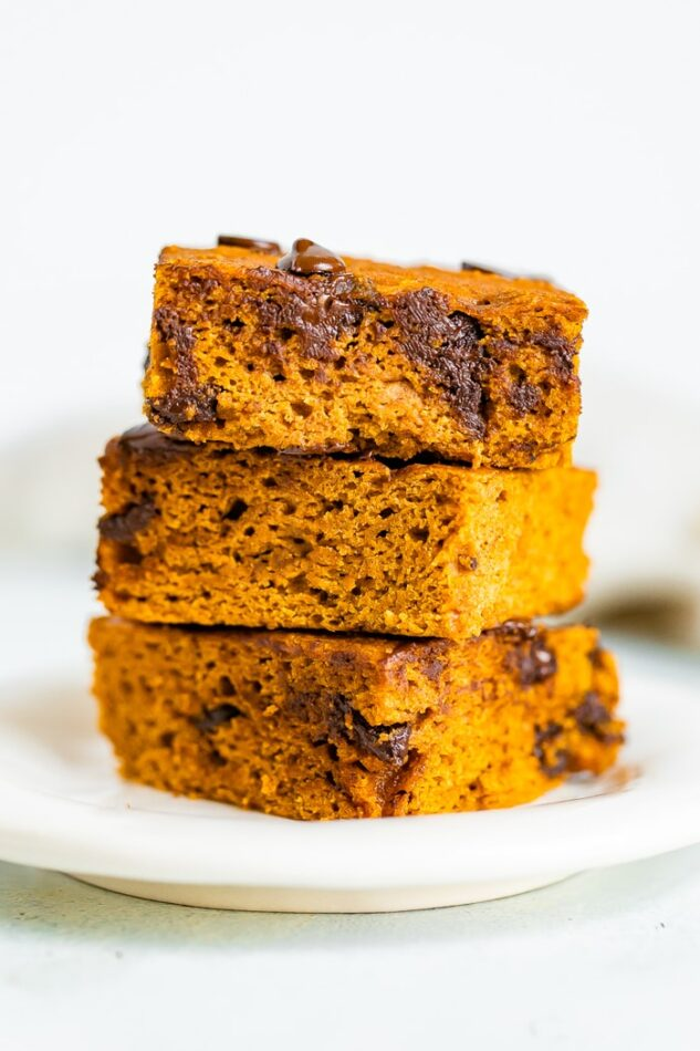 Stack of three pumpkin bars with chocolate chips.