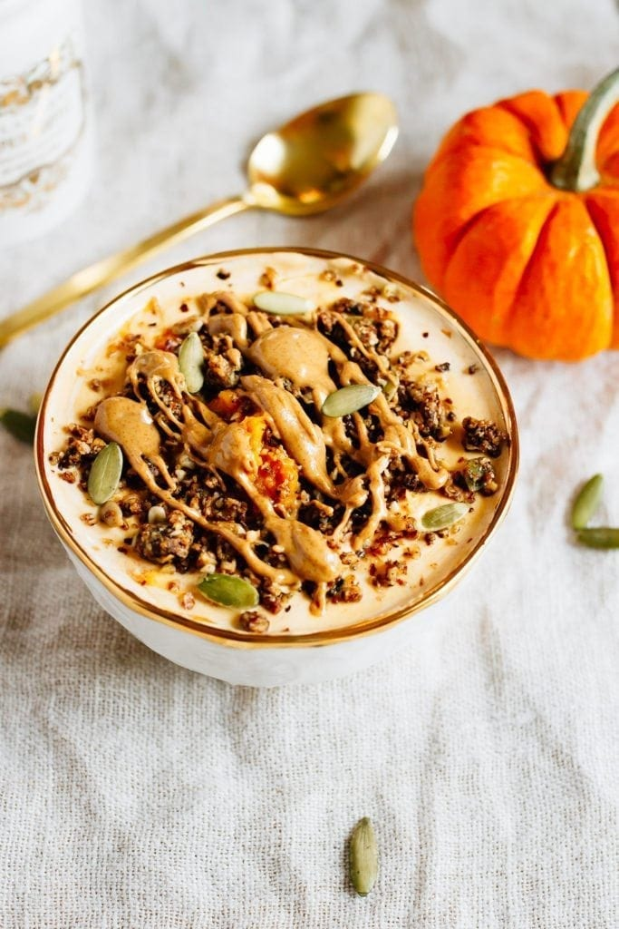 This pumpkin pie yogurt bowl is the perfect fall breakfast. Loaded with protein-packed yogurt, pumpkin puree, pumpkin pie spice and all your favorite toppings!