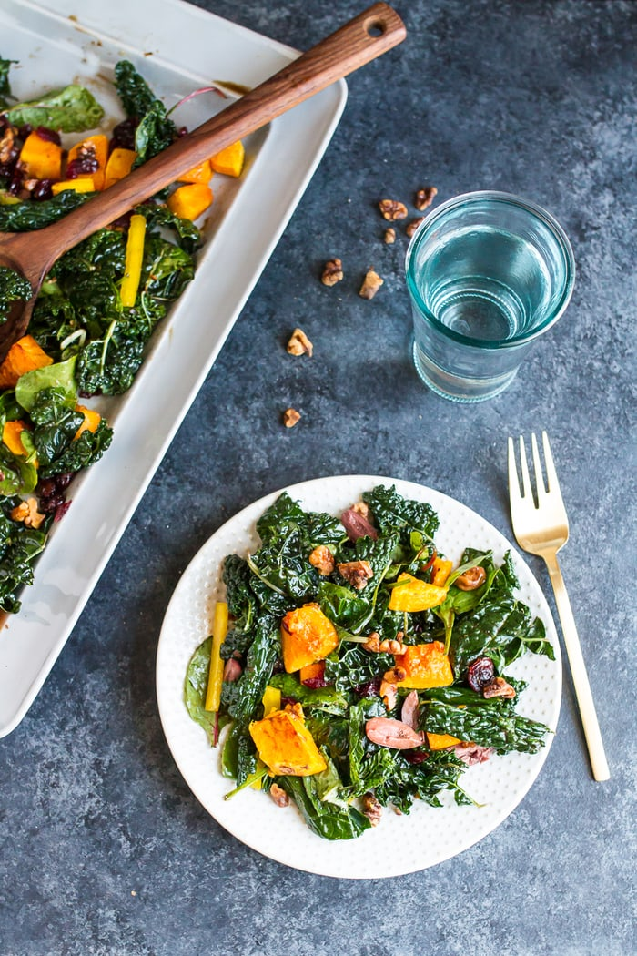 Holiday Kale Salad with roasted butternut squash, olives, walnuts and dried cranberries.