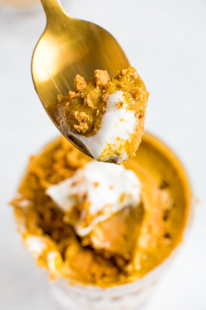 Spoonful of easy pumpkin chia mouse with some yogurt and graham cracker crumbs.