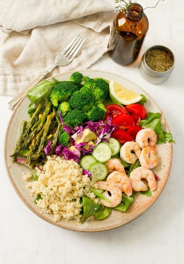A meal-sized shrimp salad with cooked shrimp, quinoa, blanched broccoli and roasted asparagus! Prepare everything ahead of time and throw it into a bowl for a quick and easy lunch or dinner.
