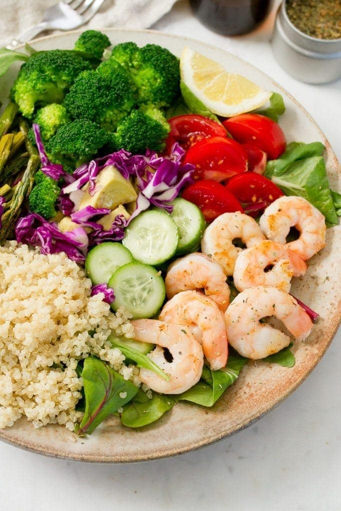A clean eating shrimp salad with cooked shrimp, quinoa, blanched broccoli and roasted asparagus! Prepare everything ahead of time and throw it into a bowl for a quick and easy lunch or dinner.
