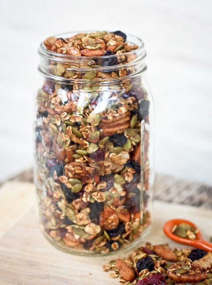 Pumpkin Spice trail mix in a mason jar made with nuts, seeds, oats and dried fruit.