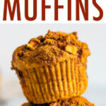 Two healthy apple muffins stacked on top of each other.