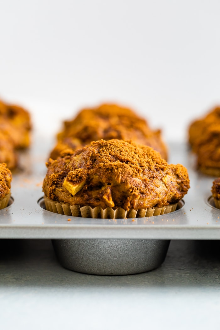 Healthy apple muffins in a muffin tin.