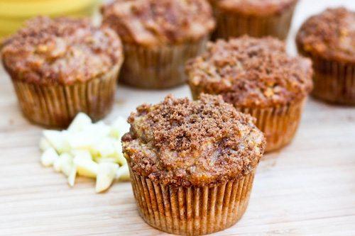 Healthy Apple Cinnamon Muffins on wood cutting board.