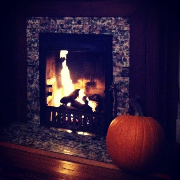fireplace with pumpkin