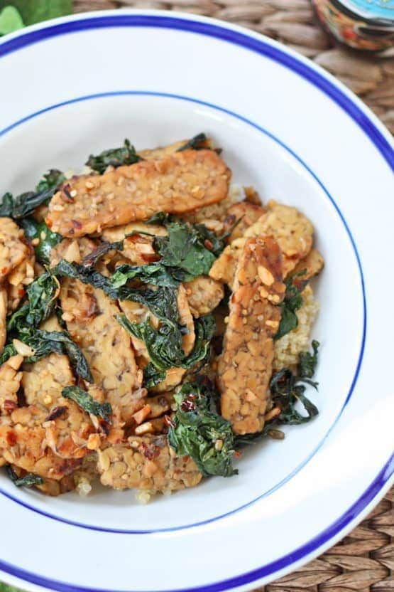 A flavorful one skillet meal with tempeh, sautéed kale and coconut aminos.
