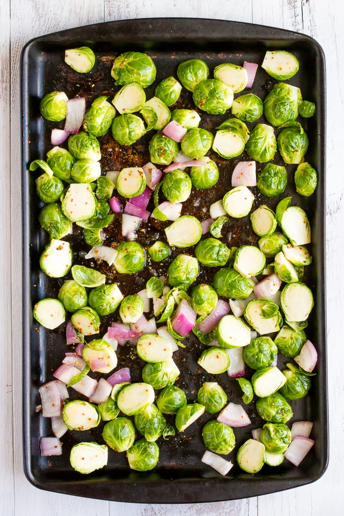 These apple cider vinegar roasted brussels sprouts are the perfect side dish for just about any occasion. You'll love the savory, sweet apple cider vinegar sauce that the sprouts are roasted in!
