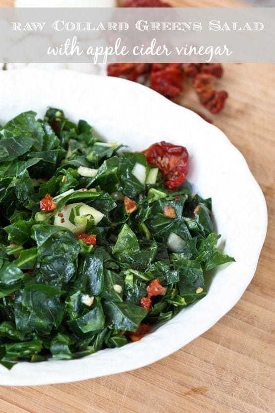Raw Collard Greens Salad with apple cider vinegar in a white serving bowl.