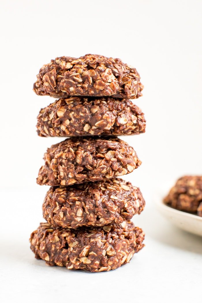 Stack of peanut butter chocolate healthy no bake cookies.