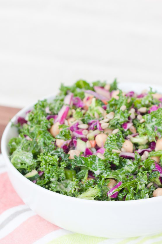 A lovely kale cabbage salad with broccoli florets, chickpeas and sunflower seeds coated with a light apple cider vinegar goddess dressing.