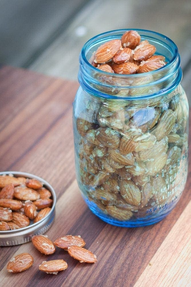 Sweet and delicious roasted almonds with maple syrup and coconut. Perfect for snacking!