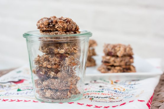Chia Oatmeal Breakfast Cookies stacked in a clear weck jar and a white plate in the background.