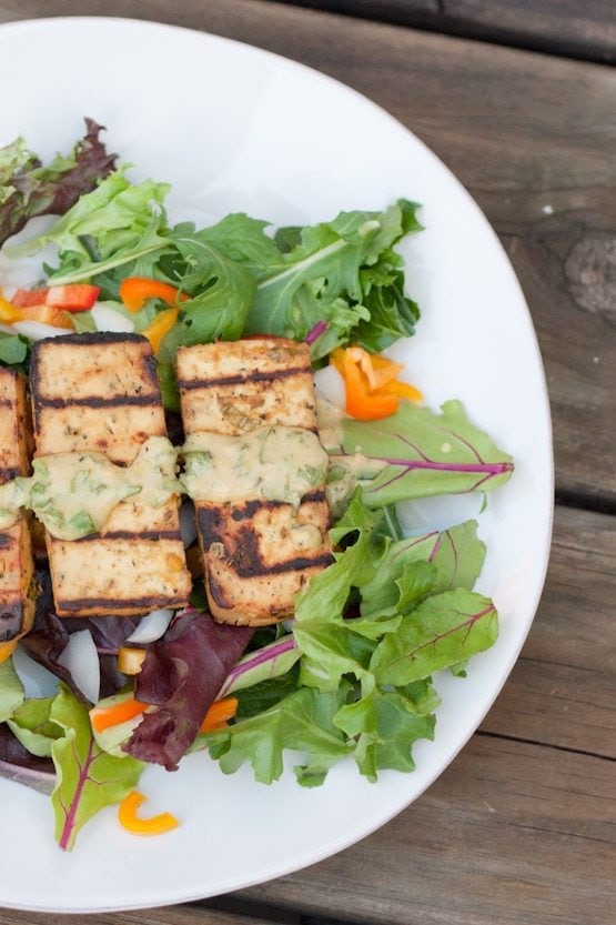 This lemon basil tofu is marinated in a zesty fresh basil sauce and grilled to perfection. It's easy and absolutely delicious!