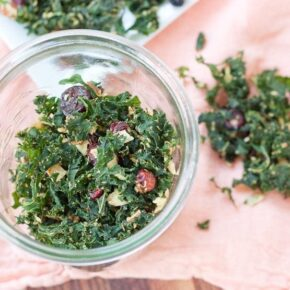Overhead shot of kale granola in a glass jar.
