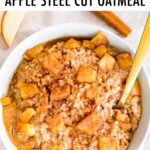 Bowl of creamy steel cut oatmeal with apples and cinnamon.