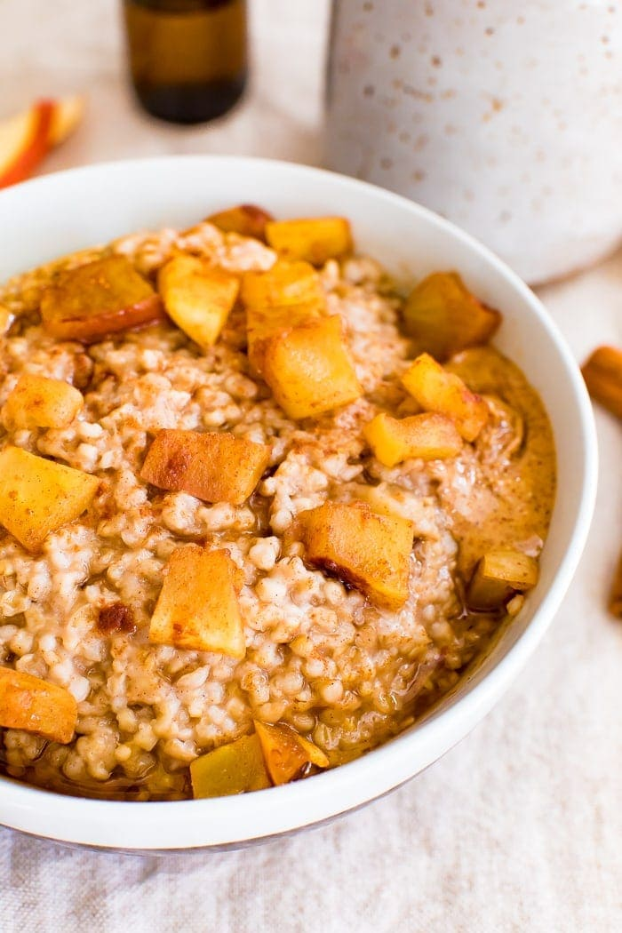 Bowl of healthy apple cinnamon oatmeal made with steel cut oats and topped with cinnamon and