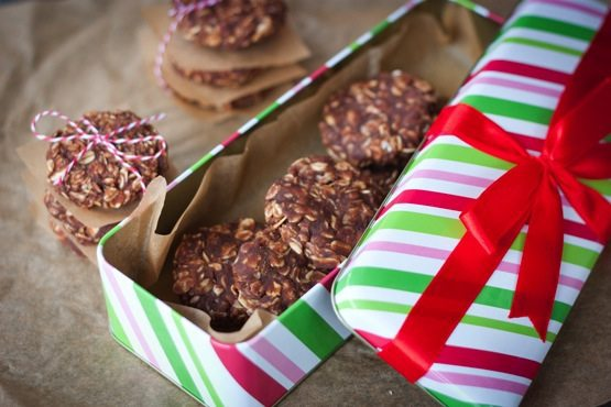 Striped rectangular green and red tin with a red bow on top filled with no bake cookies.