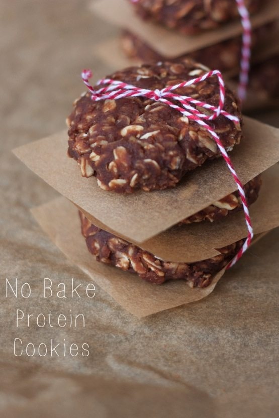 Stack of no bake protein cookies on parchment paper