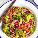 Plate with soba noodle salad with edamame and veggies.