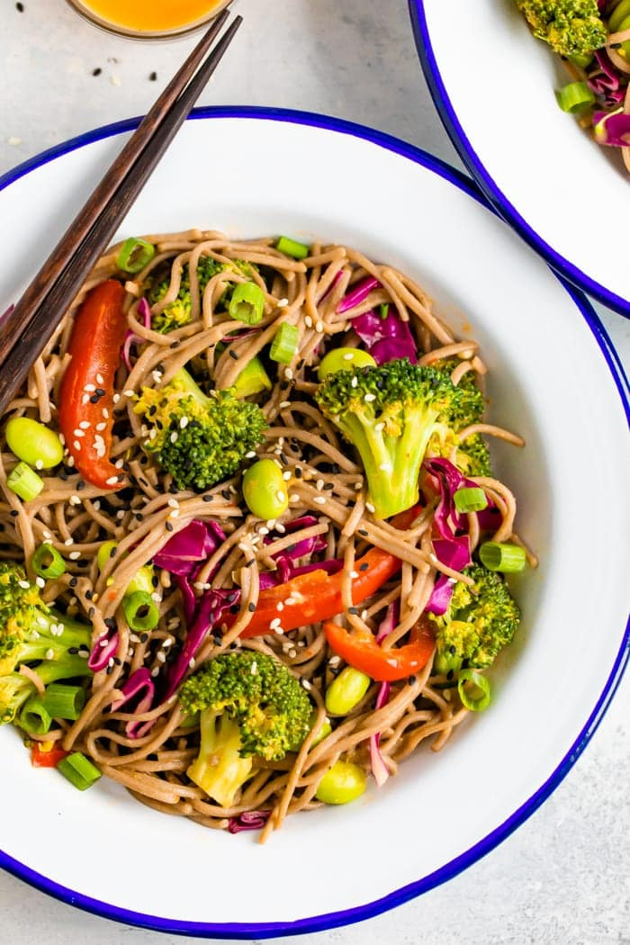 Plate with soba noodle salad made with veggies.