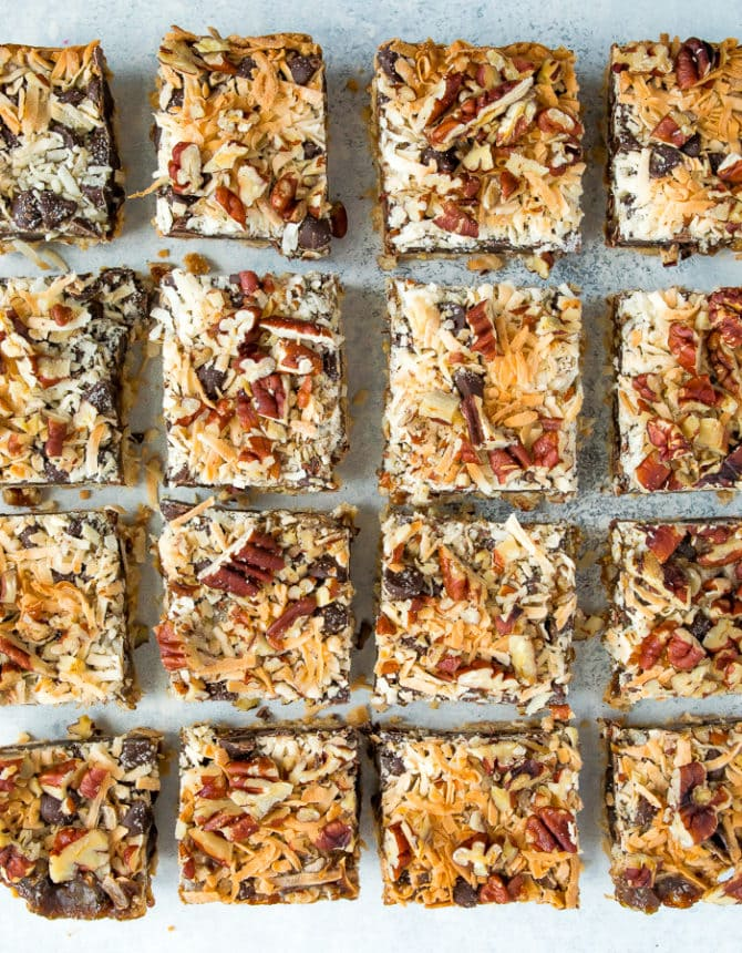 Healthier magic cookie bars. An almond flour cookie crust topped with coconut caramel, coconut, pecans, and chocolate chips.