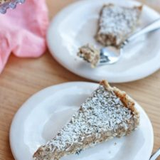 Two plates each with a slice of healthy coconut cream pie.