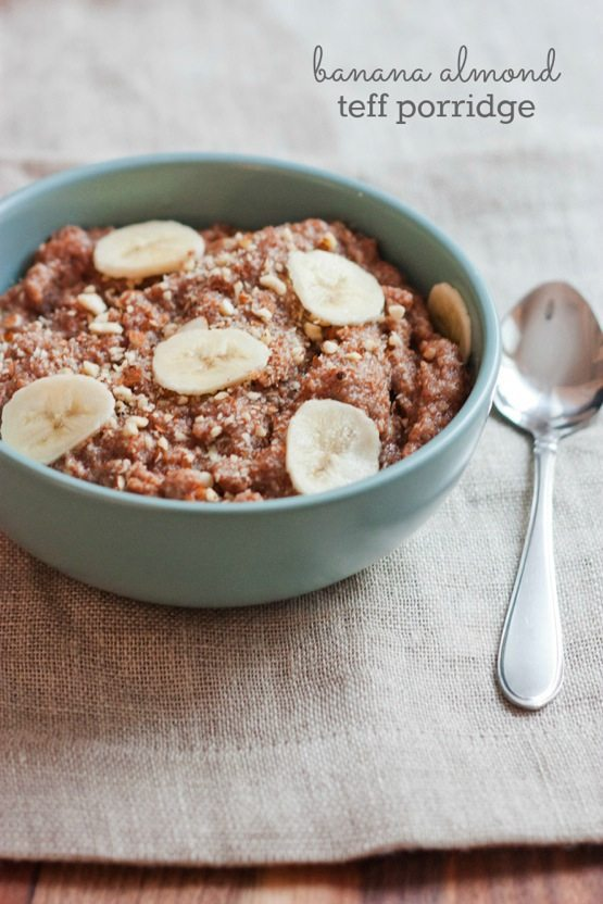 Banana Almond Teff Porridge in a light blue bowl with silver spoon.