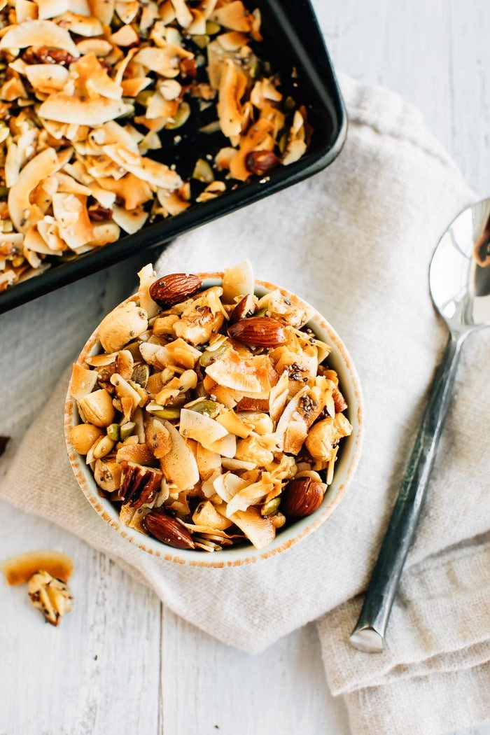 Overhead shot of a bowl with 5-Ingredient Grain Free Granola and a silver spoon.