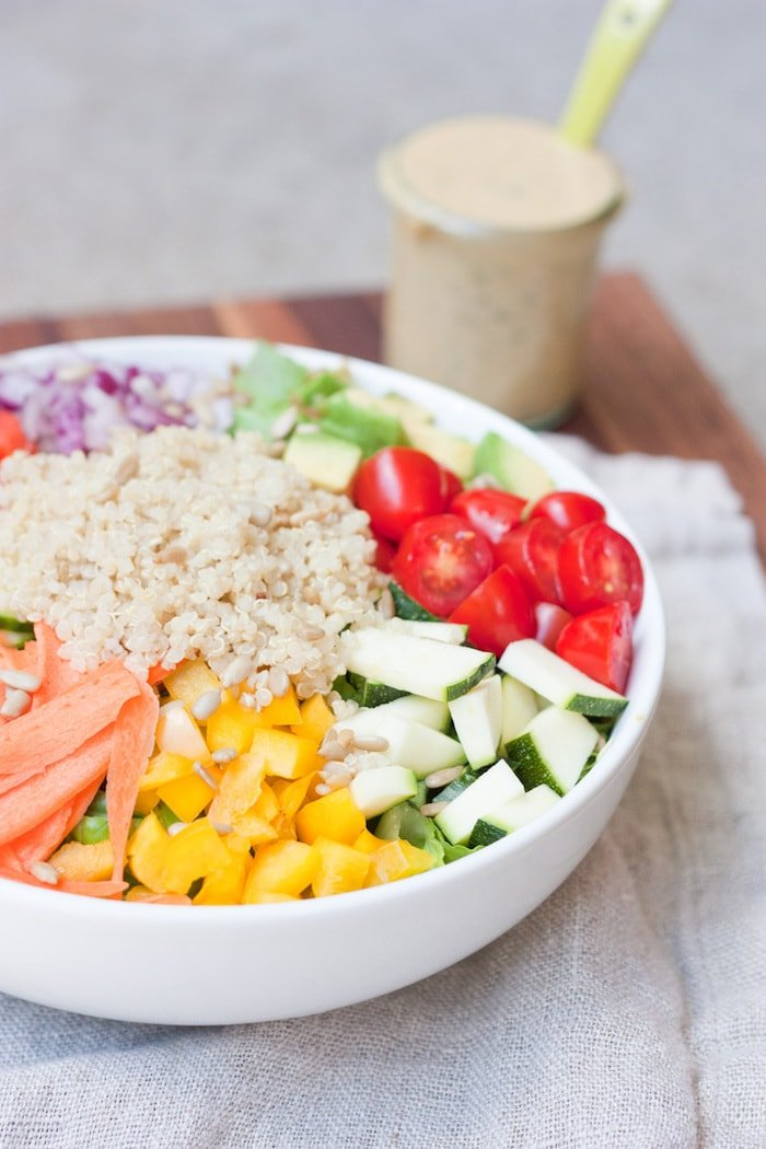 How to make the BEST curried hummus dressing plus a delicious rainbow kaleidoscipe salad!