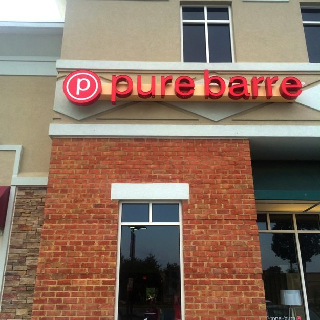 Outdoor of a Pure Barre studio - red brick walls and windows.