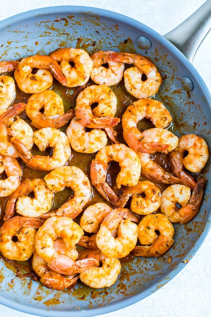 Pan with pan seared blacked shrimp.
