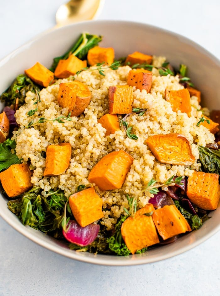 Bowl with a kale, quinoa and roasted sweet potato salad.