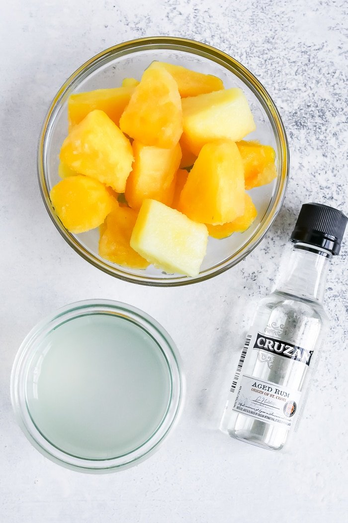 Ingredients for a skinny piña colada: frozen pineapple, coconut water and coconut rum.