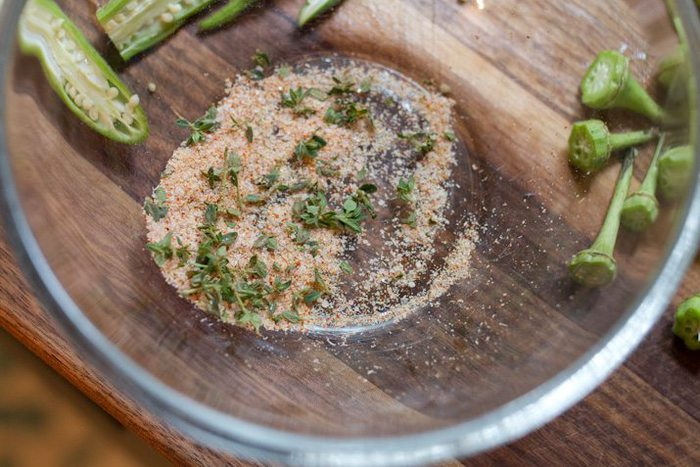 Spices in a clear bowl for roasted okra