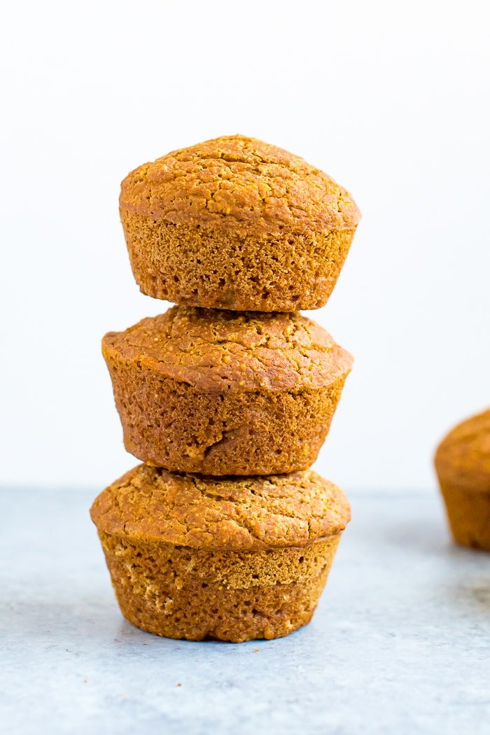 Stack of 3 healthy pumpkin cornbread muffins.