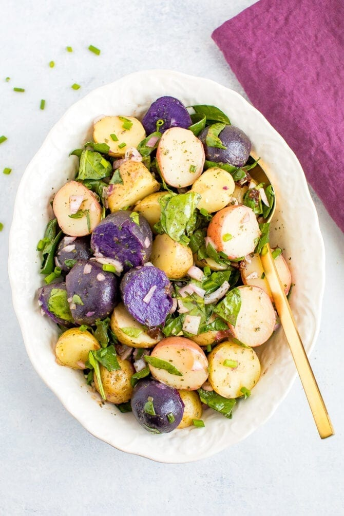 Tri-colored fingerling potato salad with shallots and spinach.