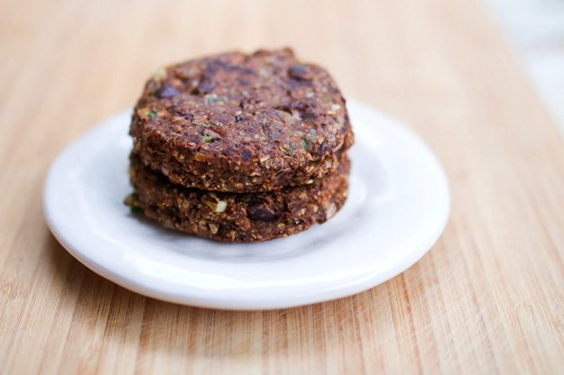 Stack of Spicy Chili Black Bean Burgers served on a white plate.