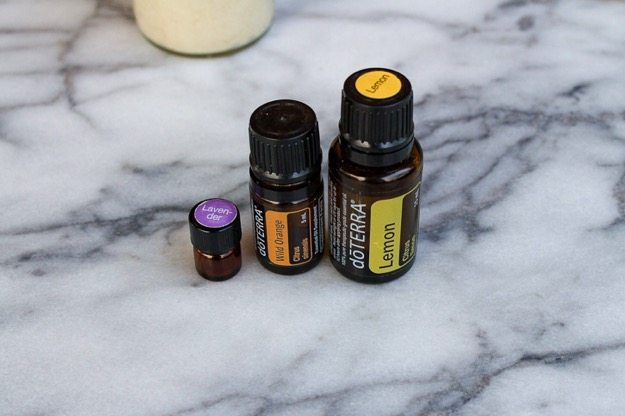 Three doTerra Essential Oils sitting on a marble countertop.
