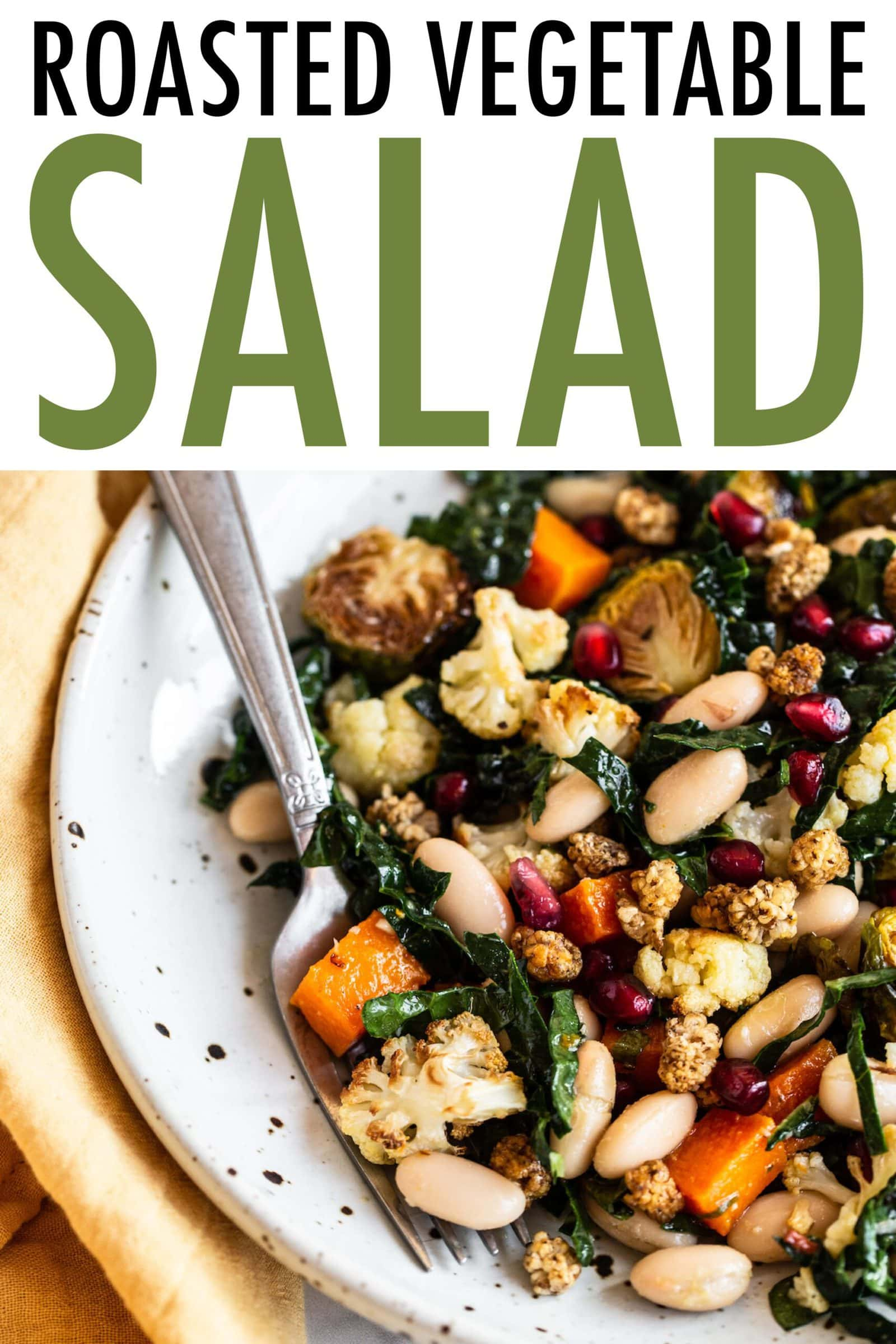 Bowl with roasted vegetable salad with kale and beans.