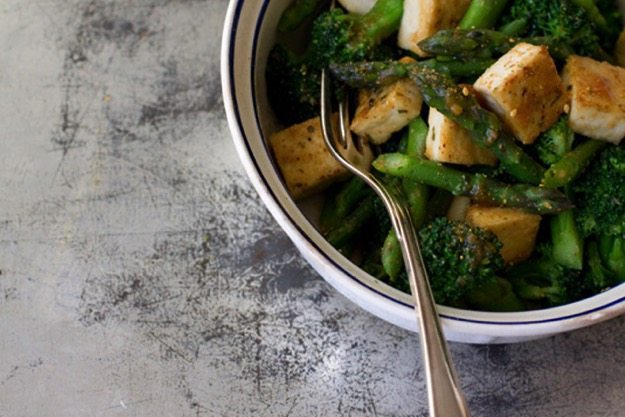 Miso Vegetables with Tofu in a white bowl on distressed countertop