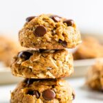 Stack of three chocolate chip peanut butter oatmeal cookies with coconut.