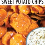 Homemade sweet potato chips next to a bowl of creamy and herby dip.