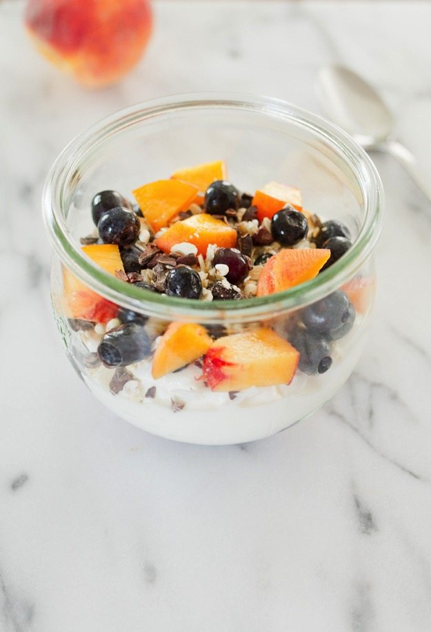 Blueberry Peach Yogurt Bowl -- loaded with protein and super easy to toss together