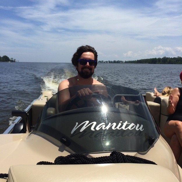 Isaac Driving the Boat