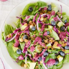 Antioxidant Salad with Blueberry Tahini Dressing, spinach salad with avocado, berries and nuts.